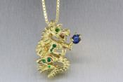 18k 3D Dragon Pendant with Green Diamond Eyes and Star Sapphire Planet